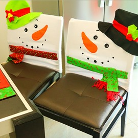 A pair of Chair Covers Snowman with Colorful Hat Pattern Christmas Decoration